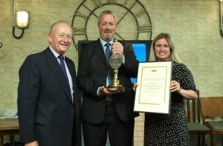 Michael Turner, Fuller's Chairman, presents Angus McKean and Claire Morgan of the Red Lion, Barnes, with their Master Cellarman of the Year award and gong